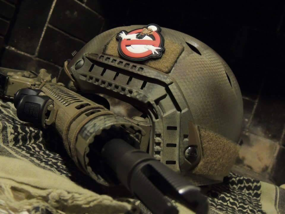 Brandon shot gear photos and shared them on the Marines of Fallujah Facebook page. Ashley owns the same Osama-Busters patch featured on his helmet. Trogdor, one of Brandon's custom-made weapons, rests next to it.